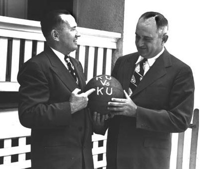"Adolph Rupp of UK and Phog Allen of KU holding a ball that for some reason says ""KU vs KU."" It's all so confusing."