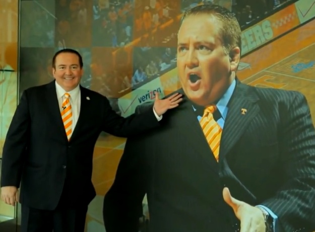 Donnie Tyndall gestures toward a large picture of Donnie Tyndall.