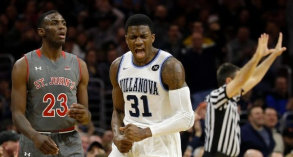 Dylan Ennis is happy about -- and Rysheed Jordan is stunned by -- the best offensive game recorded by any major-conference team this season. (AP/Matt Slocum)